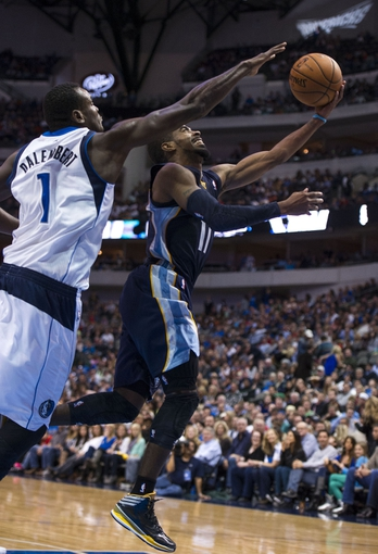 Nov 2, 2013; Dallas, TX, USA; Dallas Mavericks center Samuel Dalembert (1) defends against Memphis Grizzlies point guard Mike Conley (11) during the second half at the American Airlines Center. The Mavericks defeated the Grizzlies 111-99. Mandatory Credit: Jerome Miron-USA TODAY Sports