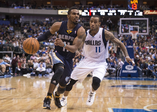 Nov 2, 2013; Dallas, TX, USA; Memphis Grizzlies point guard Mike Conley (11) drives the ball past Dallas Mavericks shooting guard Monta Ellis (11) during the second half at the American Airlines Center. The Mavericks defeated the Grizzlies 111-99. Mandatory Credit: Jerome Miron-USA TODAY Sports