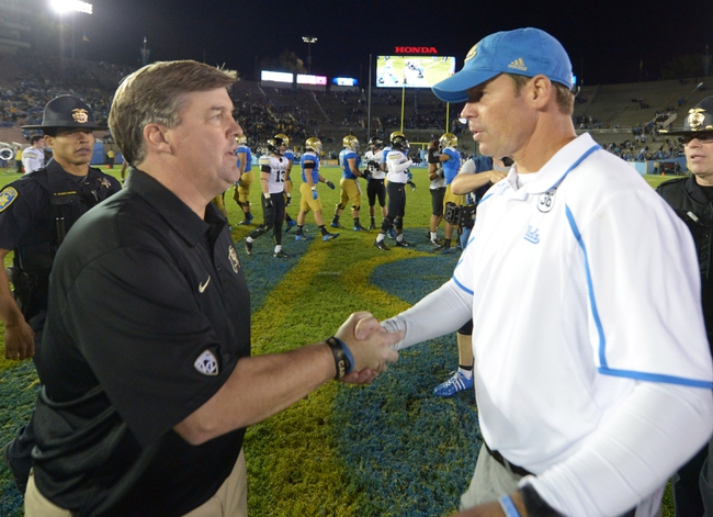 Nov 2, 2013; Pasadena, CA, USA; Colorado Buffaloes coach Mike MacIntyre (left) shakes hands with UCLA Bruins coach Jim Mora after the game at Rose Bowl. UCLA defeated Colorado 45-23. Mandatory Credit: Kirby Lee-USA TODAY Sports