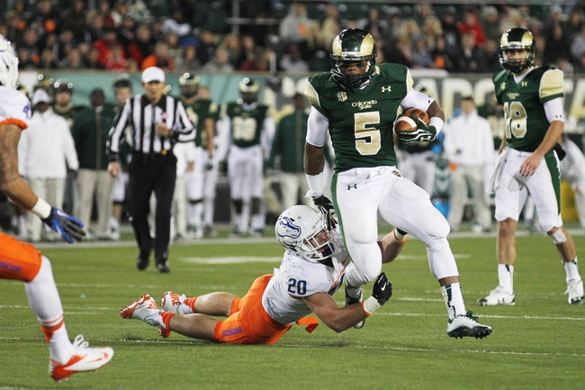 Nov 2, 2013; Fort Collins, CO, USA; Colorado State Rams running back Kapri Bibbs (5) runs against Boise State Broncos linebacker Tanner Vallejo (20) during the second quarter at Hughes Stadium. The Broncos defeated the Rams 42-30. Mandatory Credit: Troy Babbitt-USA TODAY Sports