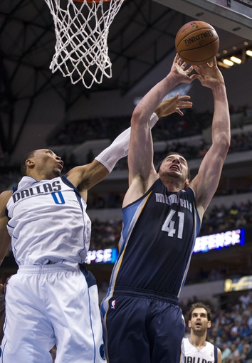 Nov 2, 2013; Dallas, TX, USA; Dallas Mavericks small forward Shawn Marion (0) defends against Memphis Grizzlies center Kosta Koufos (41) during the second half at the American Airlines Center. The Mavericks defeated the Grizzlies 111-99. Mandatory Credit: Jerome Miron-USA TODAY Sports