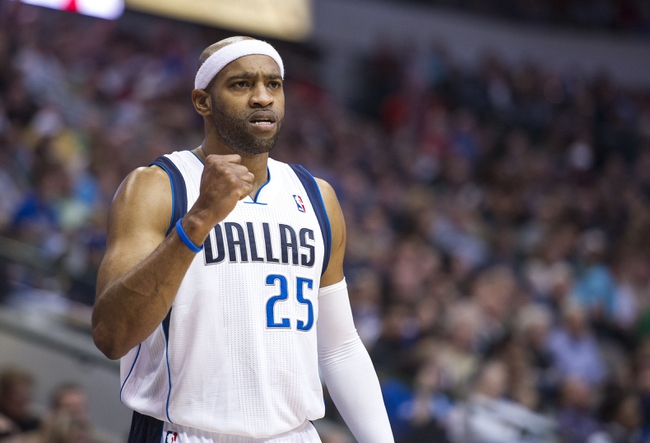 Nov 2, 2013; Dallas, TX, USA; Dallas Mavericks shooting guard Vince Carter (25) reacts to a score during the second half against the Memphis Grizzlies at the American Airlines Center. The Mavericks defeated the Grizzlies 111-99. Mandatory Credit: Jerome Miron-USA TODAY Sports