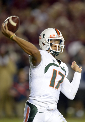 Nov 2, 2013; Tallahassee, FL, USA; Miami Hurricanes quarterback Stephen Morris (17) passes against the Florida State Seminoles during the fourth quarter at Doak Campbell Stadium. The Florida State Seminoles defeated the Miami Hurricanes 41-14. Mandatory Credit: John David Mercer-USA TODAY Sports