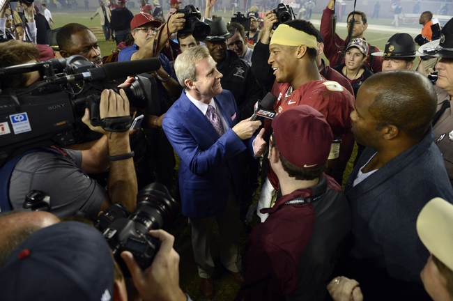 Nov 2, 2013; Tallahassee, FL, USA; Florida State Seminoles quarterback Jameis Winston (5) does a end of game interview with ESPN after defeating the Miami Hurricanes 41-14 at Doak Campbell Stadium. Mandatory Credit: John David Mercer-USA TODAY Sports