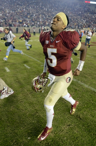 Nov 2, 2013; Tallahassee, FL, USA; Florida State Seminoles quarterback Jameis Winston (5) runs off the field following the Seminoles 41-14 victory against the Miami Hurricanes at Doak Campbell Stadium. Mandatory Credit: John David Mercer-USA TODAY Sports