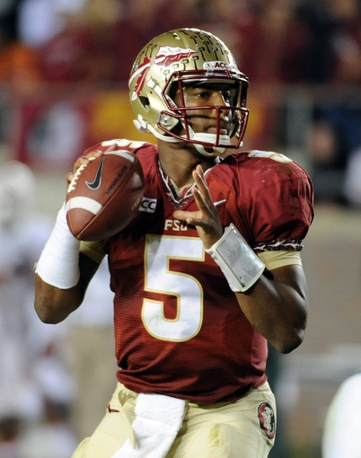 Nov 2, 2013; Tallahassee, FL, USA; Florida State Seminoles quarterback Jameis Winston (5) looks to throw the ball during the game against the Miami Hurricanes at Doak Campbell Stadium. Mandatory Credit: Melina Vastola-USA TODAY Sports