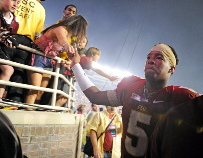 Nov 2, 2013; Tallahassee, FL, USA; Florida State Seminoles quarterback Jameis Winston (5) greets fans after the game against the Miami Hurricanes at Doak Campbell Stadium. Mandatory Credit: Melina Vastola-USA TODAY Sports