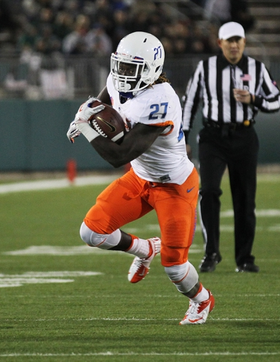 Nov 2, 2013; Fort Collins, CO, USA; Boise State Broncos running back Jay Ajayi (27) runs against the Colorado State Rams during the first quarter at Hughes Stadium. The Broncos defeated the Rams 42-30. Mandatory Credit: Troy Babbitt-USA TODAY Sports