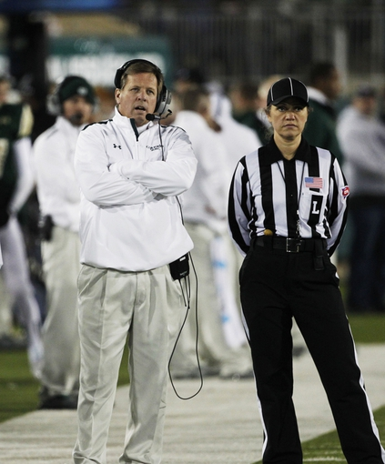 Nov 2, 2013; Fort Collins, CO, USA; Colorado State Rams head coach Jim McElwain with an official against the Boise State Broncos during the second quarter at Hughes Stadium. The Broncos defeated the Rams 42-30. Mandatory Credit: Troy Babbitt-USA TODAY Sports