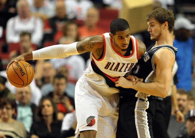 Nov 2, 2013; Portland, OR, USA; Portland Trail Blazers power forward LaMarcus Aldridge (12) dribbles against San Antonio Spurs center Tiago Splitter (22) during the fourth quarter of the game at the Moda Center. The Blazers won the game 115-105. Mandatory Credit: Steve Dykes-USA TODAY Sports