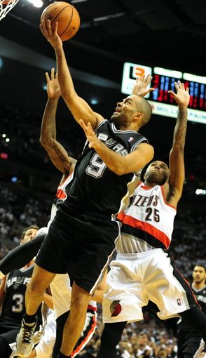 Nov 2, 2013; Portland, OR, USA; San Antonio Spurs point guard Tony Parker (9) drives to the basket on Portland Trail Blazers point guard Mo Williams (25) during the fourth quarter of the game at  the Moda Center. The Blazers won the game 115-105. Mandatory Credit: Steve Dykes-USA TODAY Sports