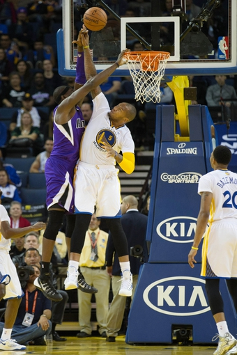 Nov 2, 2013; Oakland, CA, USA; Golden State Warriors power forward Marreese Speights (5) blocks the shot by Sacramento Kings center Hamady Ndiaye (55) during the fourth quarter at Oracle Arena. The Golden State Warriors defeated the Sacramento Kings 98-87. Mandatory Credit: Kelley L Cox-USA TODAY Sports