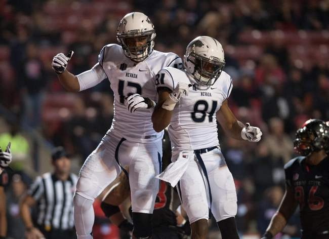 Nov 2, 2013; Fresno, CA, USA; Nevada Wolf Pack wide receiver Hasaan Henderson (12) celebrates with wide receiver Aaron Bradley (81) after scoring a touchdown during the fourth quarter of the game against the Fresno State Bulldogs at Bulldog Stadium. Fresno State won 41-23. Mandatory Credit: Ed Szczepanski-USA TODAY Sports