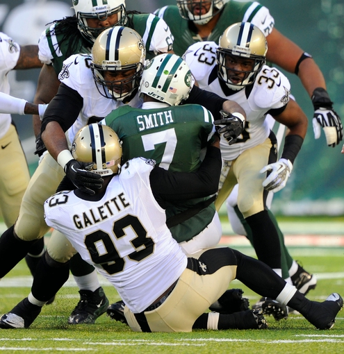 Nov 3, 2013; East Rutherford, NJ, USA; New York Jets quarterback Geno Smith (7) is sacked by New Orleans Saints outside linebacker Junior Galette (93) during the game at MetLife Stadium. Mandatory Credit: Robert Deutsch-USA TODAY Sports
