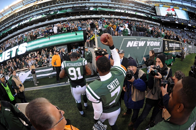 Nov 3, 2013; East Rutherford, NJ, USA; New York Jets quarterback Geno Smith (7) leaves the field after defeating the New Orleans Saints at MetLife Stadium. The Jets won the game 26-20. Mandatory Credit: Joe Camporeale-USA TODAY Sports
