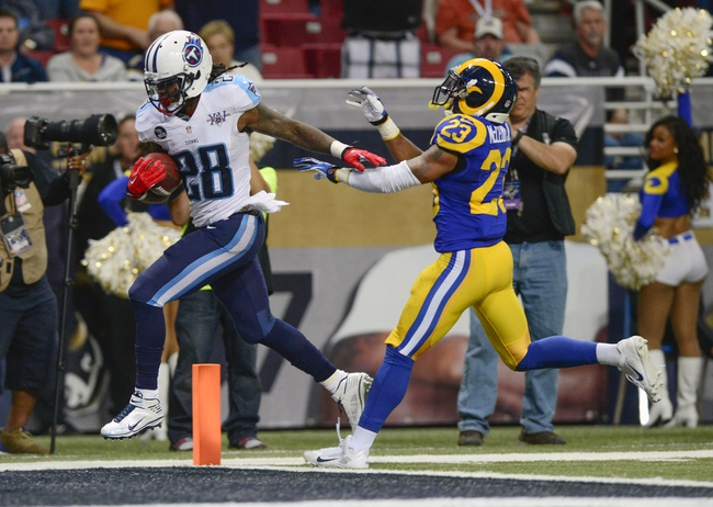 Nov 3, 2013; St. Louis, MO, USA; Tennessee Titans running back Chris Johnson (28) runs for the game winning touchdown as St. Louis Rams free safety Rodney McLeod (23) defends at the Edward Jones Dome. Tennessee defeated St. Louis 28-21. Mandatory Credit: Jeff Curry-USA TODAY Sports