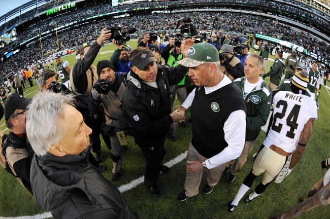 Nov 3, 2013; East Rutherford, NJ, USA; New York Jets head coach Rex Ryan and New Orleans Saints head coach Sean Payton shake hands after the second half at MetLife Stadium. The Jets won the game 26-20. Mandatory Credit: Joe Camporeale-USA TODAY Sports