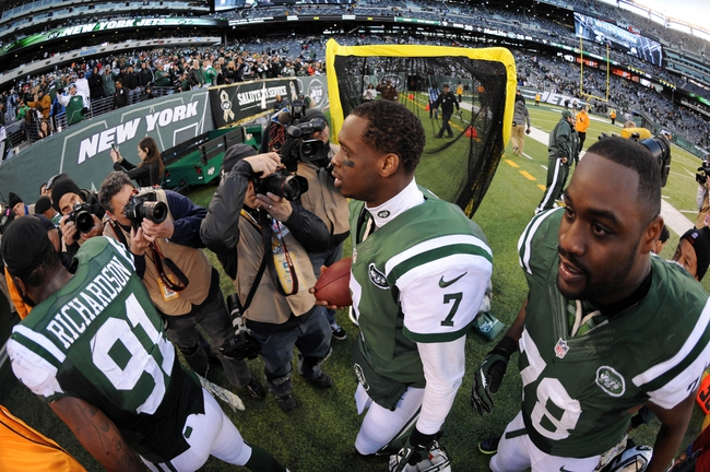 Nov 3, 2013; East Rutherford, NJ, USA; New York Jets quarterback Geno Smith (7) walks off the field after defeating the the New Orleans Saints at MetLife Stadium. The Jets won the game 26-20. Mandatory Credit: Joe Camporeale-USA TODAY Sports