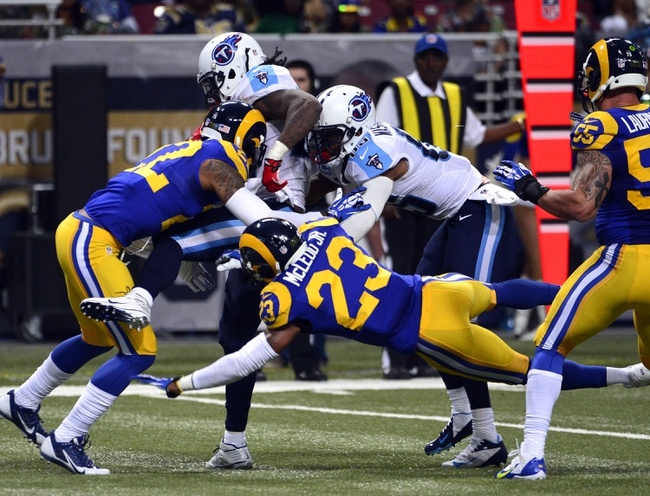 Nov 3, 2013; St. Louis, MO, USA; Tennessee Titans running back Chris Johnson (28) is pushed into the end zone by  wide receiver Nate Washington (85) as St. Louis Rams cornerback Trumaine Johnson (22) attempts to defend during the second half at the Edward Jones Dome. The Titans defeated the Rams 28-21. Mandatory Credit: Scott Rovak-USA TODAY Sports