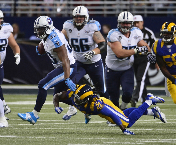 Nov 3, 2013; St. Louis, MO, USA; Tennessee Titans running back Shonn Greene (23) breaks away from St. Louis Rams cornerback Janoris Jenkins (21) during the second half at the Edward Jones Dome. The Titans defeated the Rams 28-21. Mandatory Credit: Scott Rovak-USA TODAY Sports