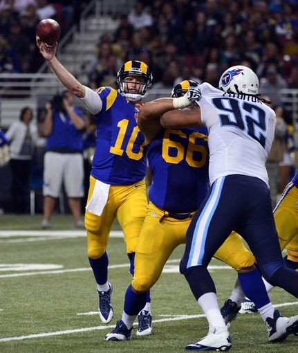 Nov 3, 2013; St. Louis, MO, USA; St. Louis Rams quarterback Kellen Clemens (10) attempts a pass against the Tennessee Titans during the second half at the Edward Jones Dome. The Titans defeated the Rams 28-21. Mandatory Credit: Scott Rovak-USA TODAY Sports