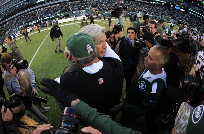 Nov 3, 2013; East Rutherford, NJ, USA; New Orleans Saints defensive coordinator Rob Ryan and New York Jets head coach Rex Ryan hug after the second half at MetLife Stadium. The Jets won the game 26-20. Mandatory Credit: Joe Camporeale-USA TODAY Sports