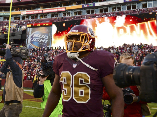 Nov 3, 2013; Landover, MD, USA; Washington Redskins fullback Darrel Young (36) walks across the field after scoring the game wining touchdown in overtime of the game at FedEx Field. The Redskins defeated the San Diego Chargers 30-24.Mandatory Credit: Tommy Gilligan-USA TODAY Sports