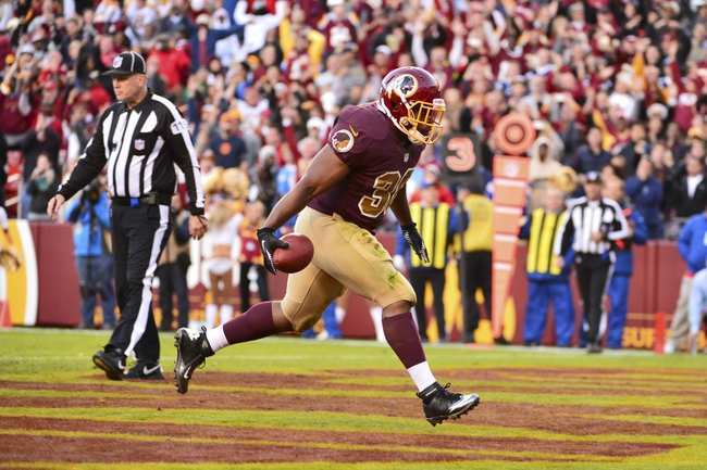 Nov 3, 2013; Landover, MD, USA; Washington Redskins fullback Darrel Young (36) runs through the end zone after scoring a touch down in overtime of the game at FedEx Field. The Redskins defeated the San Deigo Chargers 30-24. Mandatory Credit: Tommy Gilligan-USA TODAY Sports