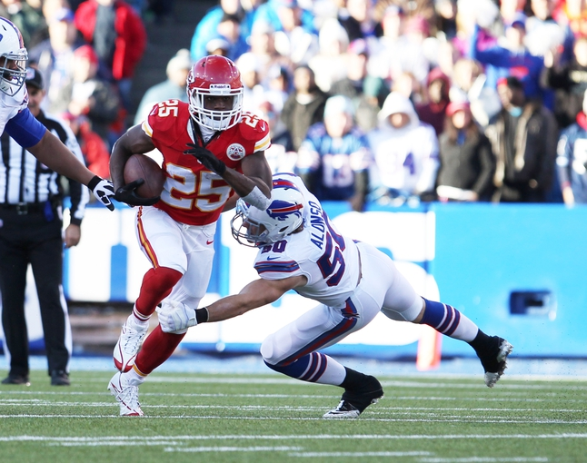 Nov 3, 2013; Orchard Park, NY, USA; Buffalo Bills middle linebacker Kiko Alonso (50) tries to make a tackle on Kansas City Chiefs running back Jamaal Charles (25) during the second half at Ralph Wilson Stadium. Chiefs beat the Bills 23 to 13.  Mandatory Credit: Timothy T. Ludwig-USA TODAY Sports