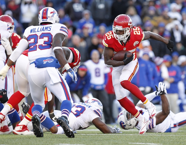 Nov 3, 2013; Orchard Park, NY, USA; Kansas City Chiefs running back Jamaal Charles (25) runs with the ball as Buffalo Bills free safety Aaron Williams (23) pursues during the second half at Ralph Wilson Stadium. Chiefs beat the Bills 23-13. Mandatory Credit: Kevin Hoffman-USA TODAY Sports