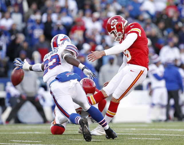 Nov 3, 2013; Orchard Park, NY, USA; Buffalo Bills free safety Aaron Williams (23) dives to try and block a field goal kick by Kansas City Chiefs kicker Ryan Succop (6) during the second half at Ralph Wilson Stadium. Chiefs beat the Bills 23-13. Mandatory Credit: Kevin Hoffman-USA TODAY Sports