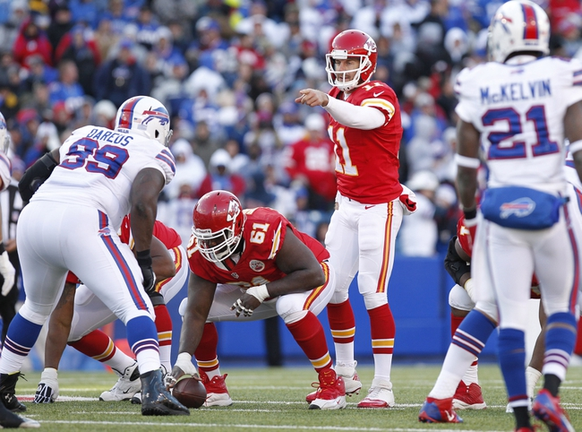 Nov 3, 2013; Orchard Park, NY, USA; Kansas City Chiefs quarterback Alex Smith (11) points to Buffalo Bills defensive tackle Marcell Dareus (99) during the second half at Ralph Wilson Stadium. Chiefs beat the Bills 23-13. Mandatory Credit: Kevin Hoffman-USA TODAY Sports