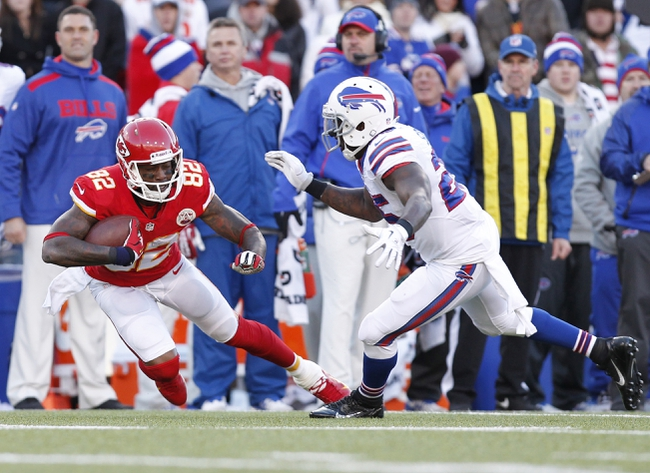 Nov 3, 2013; Orchard Park, NY, USA; Buffalo Bills strong safety Da'Norris Searcy (25) tackles Kansas City Chiefs wide receiver Dwayne Bowe (82) during the second half at Ralph Wilson Stadium. Chiefs beat the Bills 23-13. Mandatory Credit: Kevin Hoffman-USA TODAY Sports