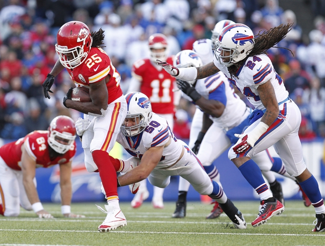 Nov 3, 2013; Orchard Park, NY, USA; Kansas City Chiefs running back Jamaal Charles (25) is tackled by Buffalo Bills middle linebacker Kiko Alonso (50) and cornerback Stephon Gilmore (24) during the second half at Ralph Wilson Stadium. Chiefs beat the Bills 23-13. Mandatory Credit: Kevin Hoffman-USA TODAY Sports