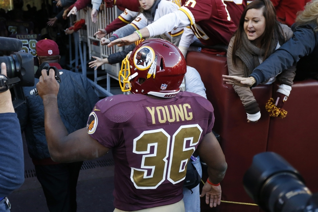 Nov 3, 2013; Landover, MD, USA; Washington Redskins fullback Darrel Young (36) walks thru fans after the game against the San Diego Chargers at FedEx Field. The Washington Redskins won 30-24 in overtime. Mandatory Credit: Geoff Burke-USA TODAY Sports