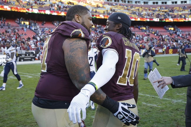Nov 3, 2013; Landover, MD, USA; Washington Redskins tackle Trent Williams (71) celebrates with Redskins quarterback Robert Griffin III (10) after their win against the San Diego Chargers 30-24 in overtime at FedEx Field. Mandatory Credit: Geoff Burke-USA TODAY Sports