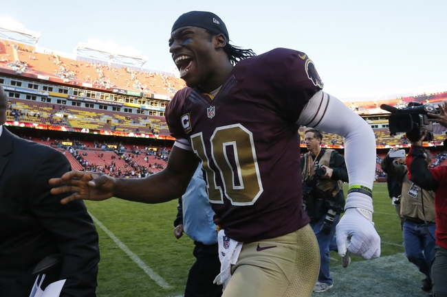 Nov 3, 2013; Landover, MD, USA; Washington Redskins quarterback Robert Griffin III (10) runs off the field after the game against the San Diego Chargers at FedEx Field. The Washington Redskins won 30-24 in overtime. Mandatory Credit: Geoff Burke-USA TODAY Sports