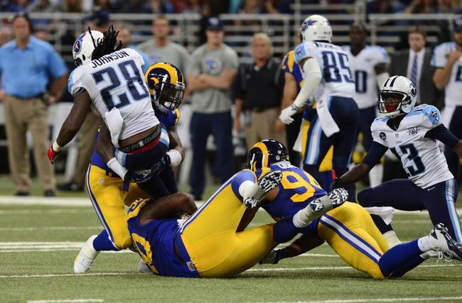 Nov 3, 2013; St. Louis, MO, USA; St. Louis Rams outside linebacker Alec Ogletree (52) tackles Tennessee Titans running back Chris Johnson (28) during the second half at the Edward Jones Dome. Tennessee defeated St. Louis 28-21. Mandatory Credit: Jeff Curry-USA TODAY Sports