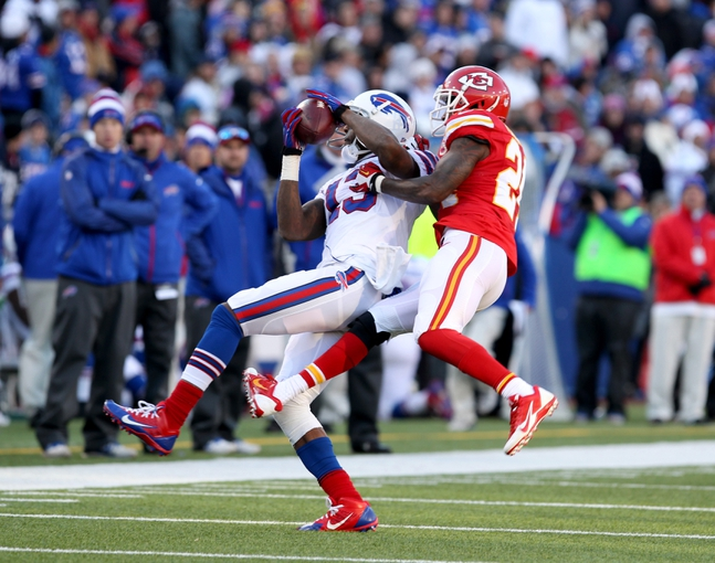 Nov 3, 2013; Orchard Park, NY, USA; Kansas City Chiefs cornerback Brandon Flowers (24) tries to break up a pass to Buffalo Bills wide receiver Steve Johnson (13) during the second half at Ralph Wilson Stadium. Chiefs beat the Bills 23 to 13.  Mandatory Credit: Timothy T. Ludwig-USA TODAY Sports