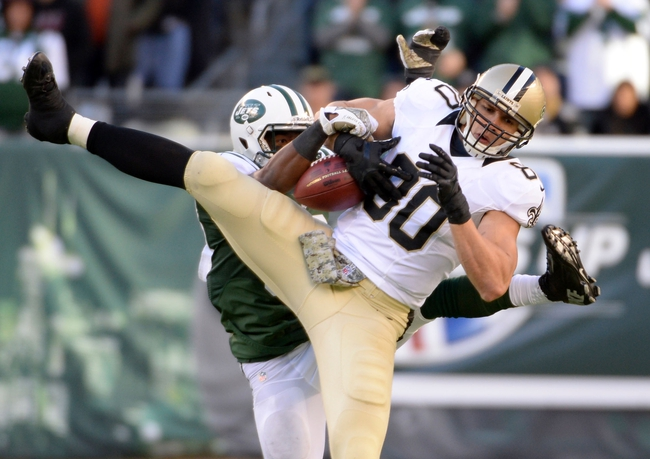 Nov 3, 2013; East Rutherford, NJ, USA; New York Jets free safety Antonio Allen breaks up a pass intended for New Orleans Saints tight end Jimmy Graham (80) during the game at MetLife Stadium. Mandatory Credit: Robert Deutsch-USA TODAY Sports