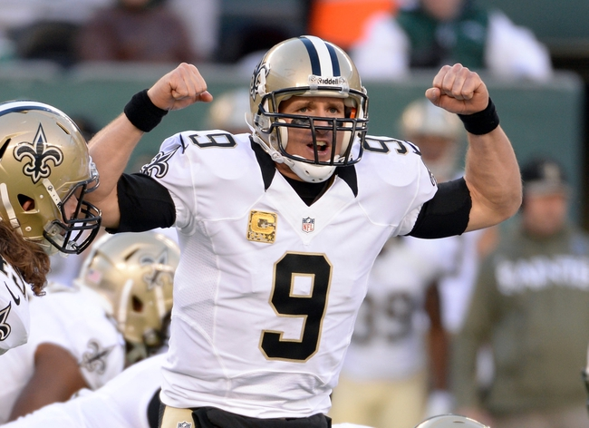 Nov 3, 2013; East Rutherford, NJ, USA; New Orleans Saints quarterback Drew Brees (9) gestures during the game against the New York Jets at MetLife Stadium. Mandatory Credit: Robert Deutsch-USA TODAY Sports
