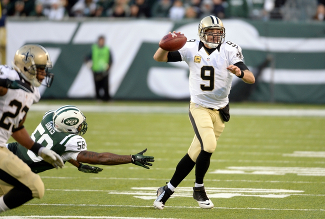 Nov 3, 2013; East Rutherford, NJ, USA; New Orleans Saints quarterback Drew Brees throws a pass against the New York Jets during the game at MetLife Stadium. Mandatory Credit: Robert Deutsch-USA TODAY Sports
