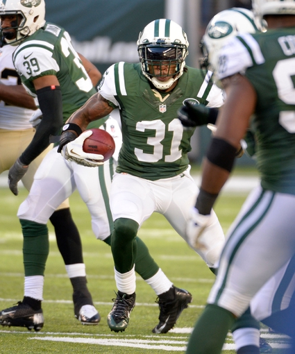 Nov 3, 2013; East Rutherford, NJ, USA; New York Jets cornerback Antonio Cromartie (31) returns an interception against the New Orleans Saints during the game at MetLife Stadium. Mandatory Credit: Robert Deutsch-USA TODAY Sports