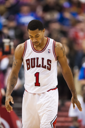 Nov 2, 2013; Philadelphia, PA, USA; Chicago Bulls guard Derrick Rose (1) during the fourth quarter against the Philadelphia 76ers at Wells Fargo Center. The Sixers defeated the Bulls 107-104. Mandatory Credit: Howard Smith-USA TODAY Sports