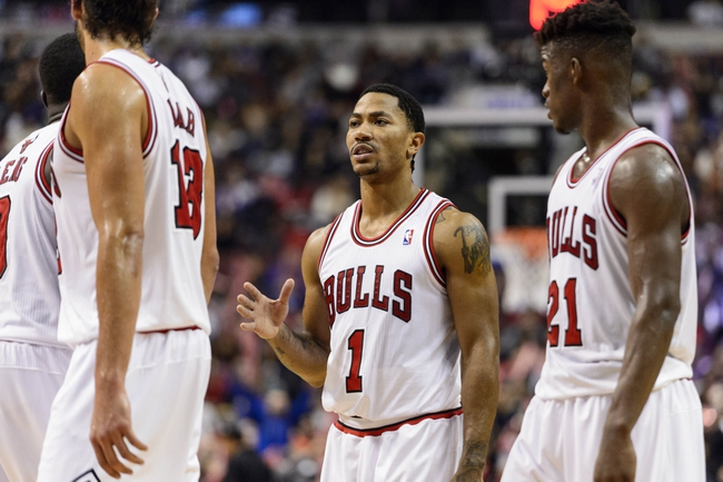 Nov 2, 2013; Philadelphia, PA, USA; Chicago Bulls guard Derrick Rose (1) talks with forward Luol Deng (9) center Joakim Noah (13) and guard Jimmy Butler (21) during the fourth quarter against the Philadelphia 76ers at Wells Fargo Center. The Sixers defeated the Bulls 107-104. Mandatory Credit: Howard Smith-USA TODAY Sports