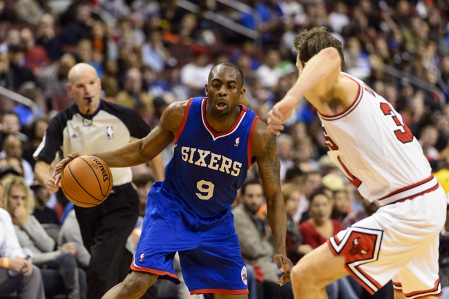 Nov 2, 2013; Philadelphia, PA, USA; Philadelphia 76ers guard James Anderson (9) is defended by Chicago Bulls forward Mike Dunleavy (34) during the fourth quarter at Wells Fargo Center. The Sixers defeated the Bulls 107-104. Mandatory Credit: Howard Smith-USA TODAY Sports