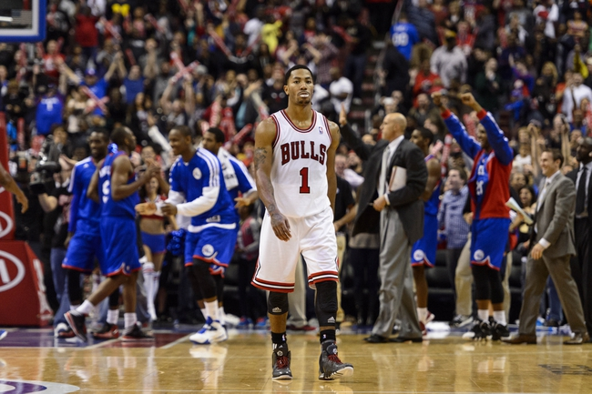 Nov 2, 2013; Philadelphia, PA, USA; Chicago Bulls guard Derrick Rose (1) walks off the court after losing to the Philadelphia 76ers at Wells Fargo Center. The Sixers defeated the Bulls 107-104. Mandatory Credit: Howard Smith-USA TODAY Sports