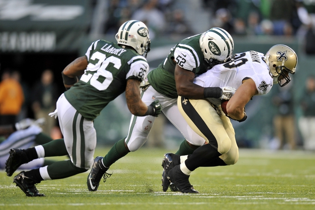 Nov 3, 2013; East Rutherford, NJ, USA; New York Jets inside linebacker David Harris (52) tackles New Orleans Saints tight end Jimmy Graham (80) after a catch during the second half at MetLife Stadium. The Jets won the game 26-20. Mandatory Credit: Joe Camporeale-USA TODAY Sports