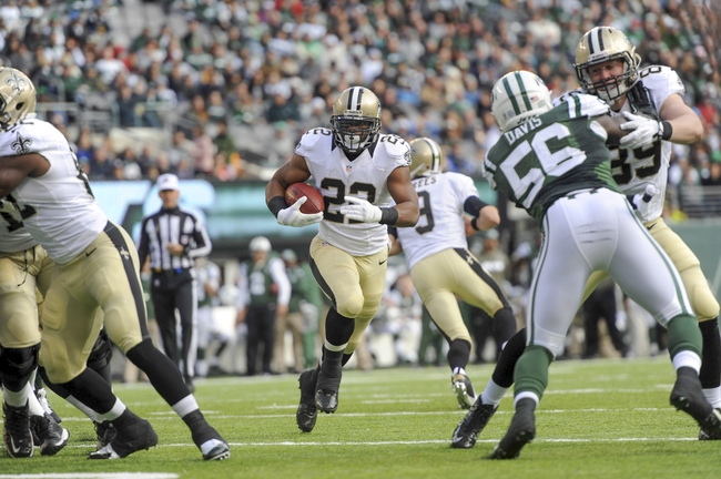 Nov 3, 2013; East Rutherford, NJ, USA; New Orleans Saints running back Mark Ingram (22) runs the ball against the New York Jets during the first half at MetLife Stadium. The Jets won the game 26-20. Mandatory Credit: Joe Camporeale-USA TODAY Sports