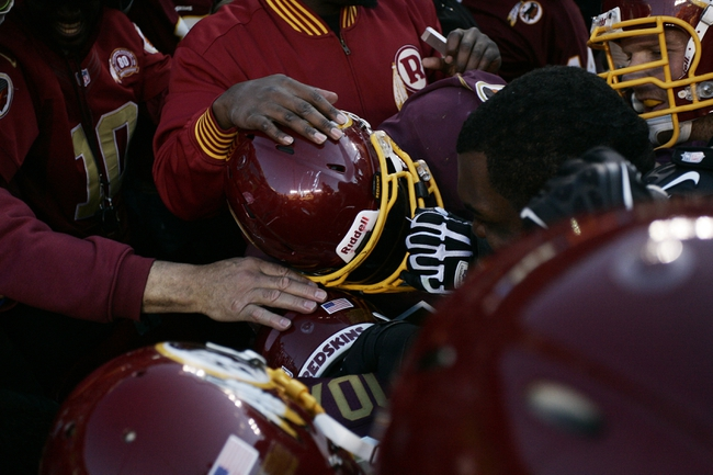 Nov 3, 2013; Landover, MD, USA; Washington Redskins fullback Darrel Young (36) is mobbed by teammates after scoring there game winning touchdown in overtime against the San Diego Chargers at FedEx Field. The Redskins won 30--24 in overtime. Mandatory Credit: Geoff Burke-USA TODAY Sports